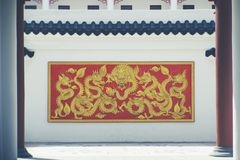 Golden dragon on the wall. Vintage style of golden dragon on the wall. tradition of Chinese royalty free stock photo