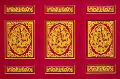 Golden dragon on wood in chinese temple. Golden dragon on red background in chinese temple, Thailand Stock Photos