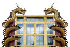 Golden dragon wrapped around wooden pole Stock Image