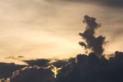 Golden dramatic sky with cloud shape dragon Royalty Free Stock Photo