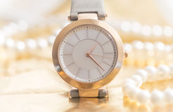 Golden dream. Gold woman wrist watch concept Royalty Free Stock Photography