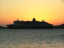 Golden Dreams. The Queen Mary II leaving port in St. Thomas during another golden sunset Stock Images