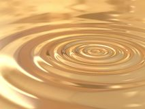 Golden drop. Gold circles generated by a drop royalty free stock images