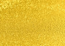 Golden drops. Surface from golden drops with a beautiful zone off focus Stock Photography