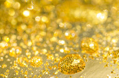 Golden drops background Royalty Free Stock Images