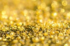 Golden drops background Stock Photos