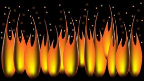 Golden drops of fire falling from the night sky. flames flying up into the night sky Royalty Free Stock Photo