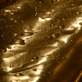 Golden drops of water. Abstract background of golden drops of water royalty free stock images