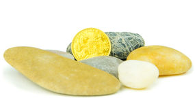 Golden ducat coin with grey pebble stones Stock Image