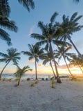 Golden dusk sun light at sunset on beautiful tropical beach with. Deckchairs at Lefaga, Matautu, Upolu Island, Western Samoa, South Pacific Stock Images