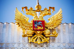 Golden eagle near Kremlin in Moscow, Russia. Golden eagle coat of arms symbol on the building near Kremlin in Moscow, Russia royalty free stock photography