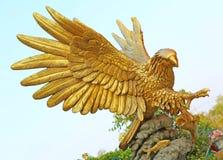 Golden Eagle Statue Against Blue Sky Stock Image