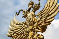 Golden eagle symbol of the emblem of Russia. On a sunny day royalty free stock images