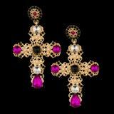 Golden earring with almandine. Golden earring with diamond and almandine stock photos