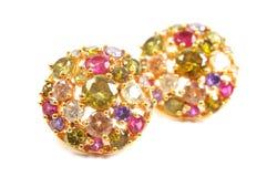 Golden earrings Stock Images