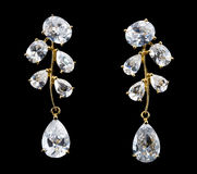 Golden earrings with diamonds Stock Images