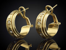 Golden earrings with gemstone isolated on black background Royalty Free Stock Photo