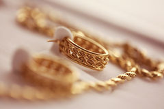 Golden earrings and necklace Stock Image