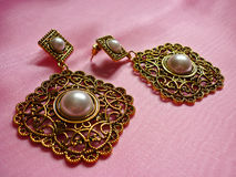 Golden earrings with pearls, vintage style Stock Photos
