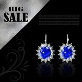 Golden earrings with sapphire and diamonds Royalty Free Stock Photo