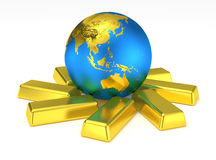 Golden Earth planet on gold bars. Glossy globe sitting on ingots. Global gold market. World business element Royalty Free Stock Photography