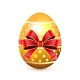 Golden Easter egg with bow Stock Photography