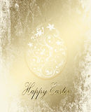 Golden Easter  egg,bunny peeking Royalty Free Stock Images