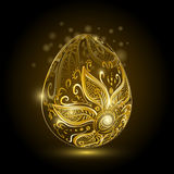 Golden easter egg with floral ornament. Stock Image