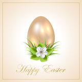 Golden Easter egg and flower Royalty Free Stock Photo