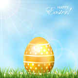 Golden Easter egg in a grass Stock Photo
