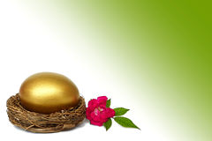 Golden Easter egg in the nest and a rose Royalty Free Stock Images