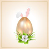 Golden Easter egg and rabbit ears Royalty Free Stock Image