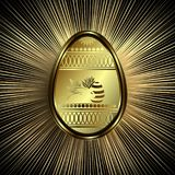 Golden easter egg with rabbit. Golden Easter egg with a rabbit and golden rays of light Stock Photo