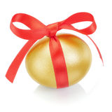 Golden easter egg with red bow. Royalty Free Stock Image