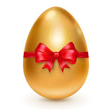 Golden Easter egg with red bow Stock Image