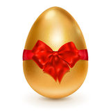 Golden Easter egg with red bow Stock Photo