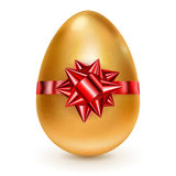 Golden Easter egg with red bow Stock Images