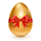 Golden Easter egg with red bow Royalty Free Stock Image