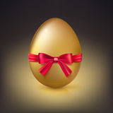 Golden Easter egg with red ribbon and bow vector illustration. Stock Photography