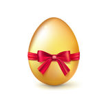 Golden Easter egg with red ribbon and bow vector illustration. Stock Photo