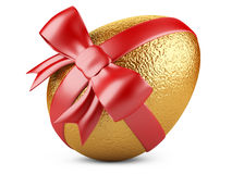 Golden easter egg with red ribbon Royalty Free Stock Images