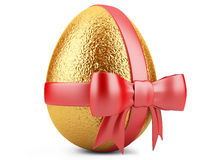 Golden easter egg with red ribbon Stock Image
