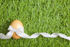 Golden easter egg with ribbon Royalty Free Stock Photography