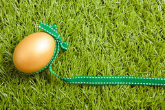 Golden easter egg with ribbon Royalty Free Stock Photos