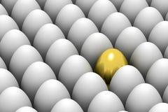Golden easter egg among similar white eggs Stock Image