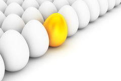 Golden Easter Egg standing out from the white eggs Royalty Free Stock Images