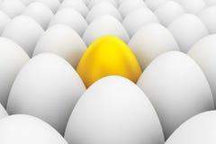 Golden Easter Egg standing between the white eggs Stock Images