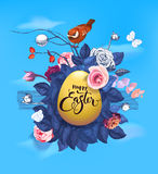 Golden Easter egg, text handwritten with calligraphic font, bunch of semi-colored flowers and little bird sitting on top. Of it against blue sky and white Stock Photos