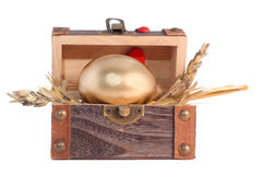 Golden Easter egg in the wooden gift box. Isolated on white Stock Image