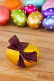 Golden easter egg on wooden table Royalty Free Stock Images